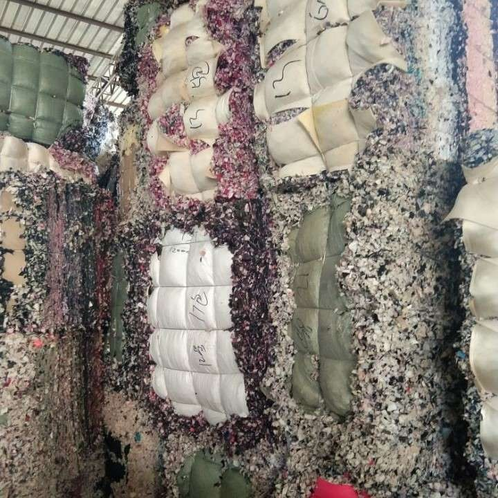 Shredded foam scrap with textile