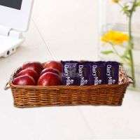 Apples in Basket along Dairy Milk Chocolates Manufacturer