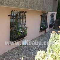 Hand forged iron windows security grills Manufacturer